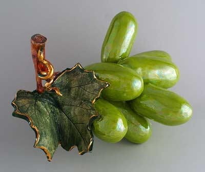 Green grapes highlighting leaf, gold trim